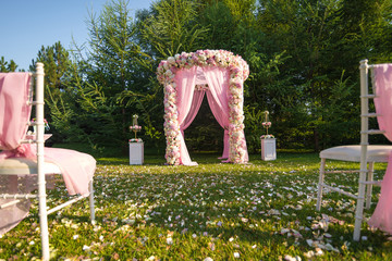 Weddind arch altar on the lawn. Europe ceremony tradition