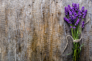 Lavender flowers, bouquet on wooden background, top view