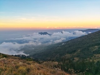 sea of cloud on the top of mountain. Beautiful nature in sunset time.