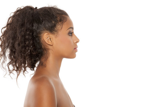 Profile of a beautiful young dark-skinned woman on a white background