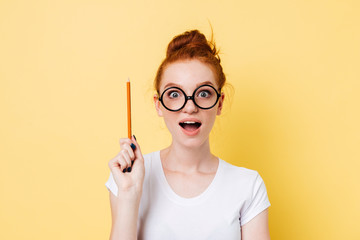 Happy ginger woman in eyeglasses having idea Fototapete