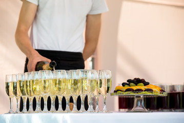 Waiter is pouring champagne outdoor