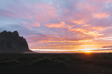 Sunrise at Stokksnes beach Iceland with mountain and orange and purple clouds
