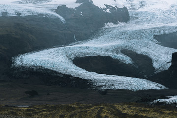Glacier in Iceland between mountain range