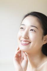 Smiling woman touching her cheek