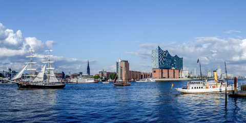 Hamburg with panoramic view of the Elbphilharmonie and in the foreground sailing ship and steamer