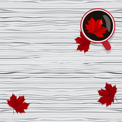 Coffee time. A hot Cup of coffee on wooden grey background. Autumn decoration. Bright autumn red maple leaves