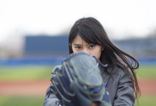 Female student preparing to throw a baseball