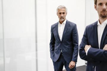 Portrait of two businessmen in office
