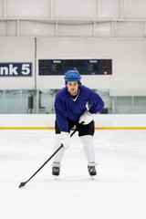 Portrait of player playing ice hockey at rink