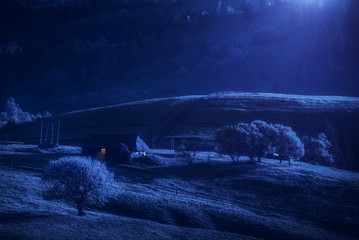 Carpathian village hills in a moonlight