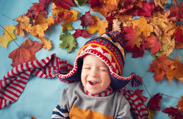 two years old boy dreaming in autumn