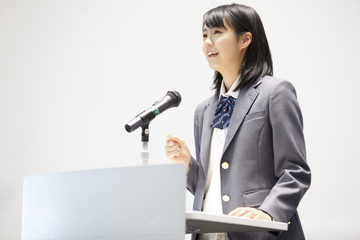 High school girl talking at podium