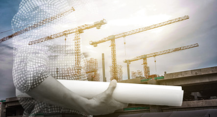 Double exposure of engineer and construction buliding