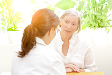 senior patient consulting female doctor