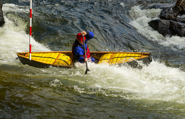 Paddling out of the slalom gate