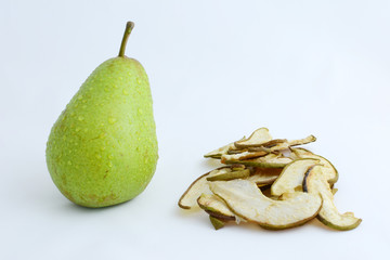 Ripe organic and dried pears on a white background.