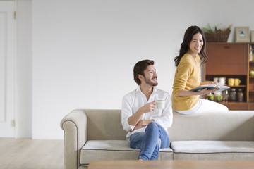 Man and woman relaxing on sofa