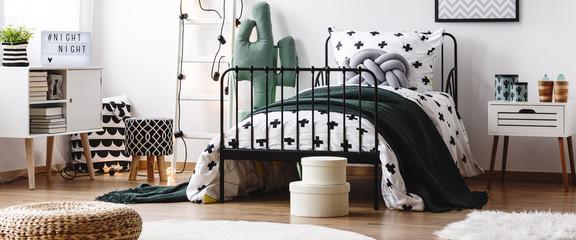 Dark blanket on kid's bed