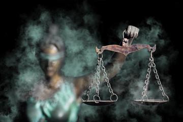 Lady Justice shows the Scale of Justice through fog (Concept of hoping in Justice)