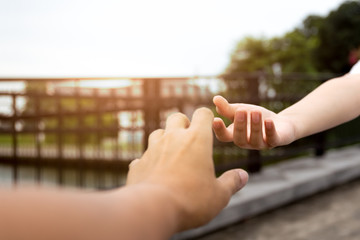Man and woman hand reaching to each other