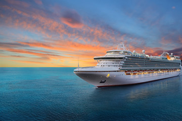Luxury cruise ship sailing to port on sunrise  Wall mural