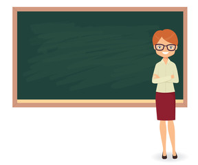 Young female teacher against a blackboard background