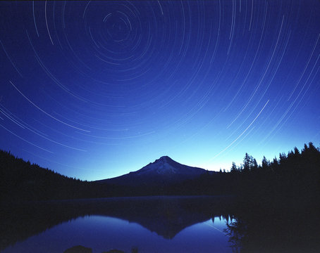 Majestic view of Trillium Lake by Mt Hood against star trails