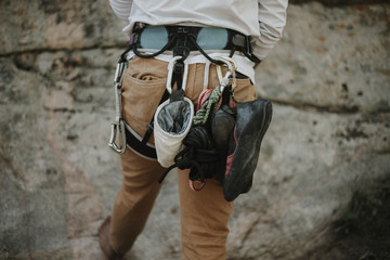 Rear view of man with climbing equipment