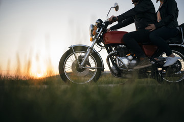 Low section of young couple on motorcycle