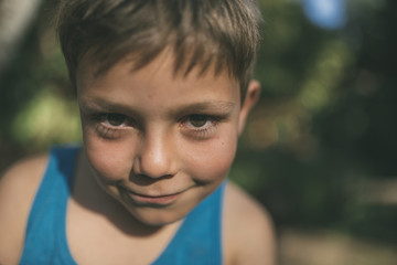 Portrait of boy at park