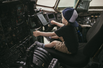 Boy sitting in cockpit