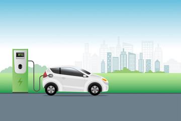 Electric car charging at charger service station front of eco city background. Hybrid Vehicle, Eco friendly auto or electric vehicle concept.
