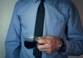 Businessman having cup of coffee.