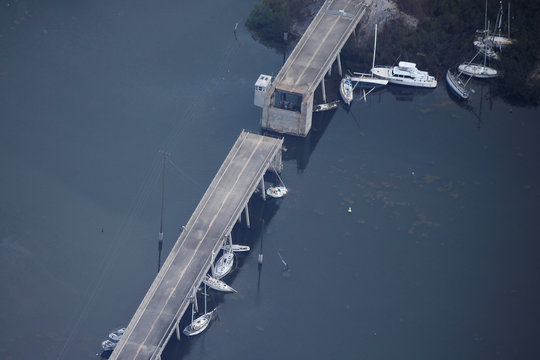 A bridge with boats washed up under it are pictured in an aerial photo in the Keys in Marathon, Florida