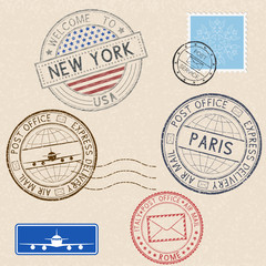Postmarks and tourist stamps on beige background
