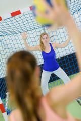 sportswoman throwing a handball ball