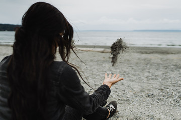 Woman throwing sand
