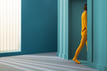woman with yellow clothes leaving the room