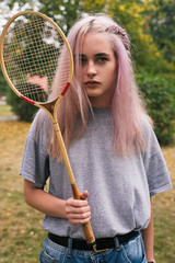 Pink-haired woman with retro badminton racket