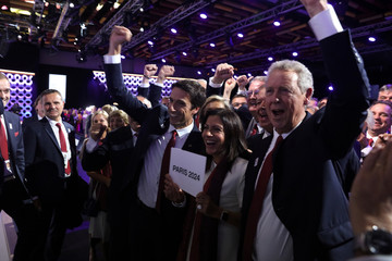 Tony Estanguet, Anne Hidalgo and Guy Drut react after the ratification of Paris 2024 and Los Angeles 2028 host cities for Olympic games during the 131st IOC session in Lima