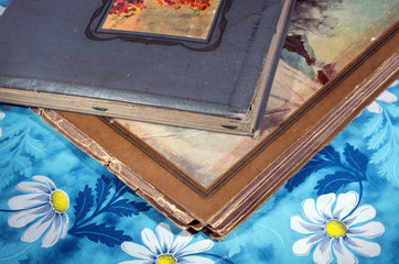 Old albums on the tablecloth with daisies.