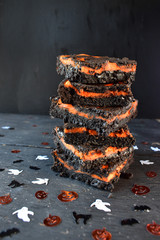 Halloween brownies stacked with dark background