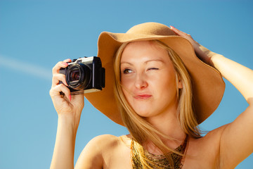 Beautiful elegant woman caught on taking pictures