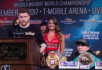 Boxer Canelo Alvarez of Mexico speaks as boxer Gennady Golovkin of Kazakhstan looks on during a news conference in Las Vegas