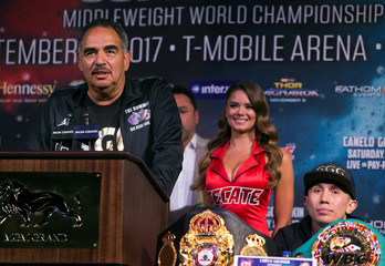 Coach Abel Sanchez speaks as boxer Gennady Golovkin of Kazakhstan looks on during a news conference in Las Vegas