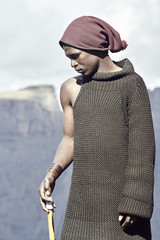 Portrait of a young male black Basotho shepherd.