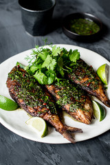 Fried sea bream with coriander, chily and fish sauce