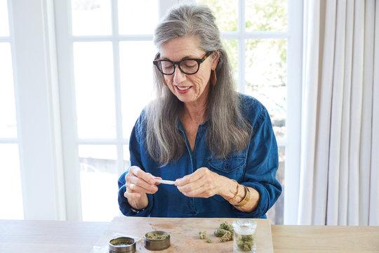 Senior woman using medical marijuana/cannabis
