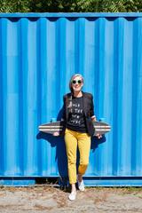 Hip and stylish senior woman with skateboard